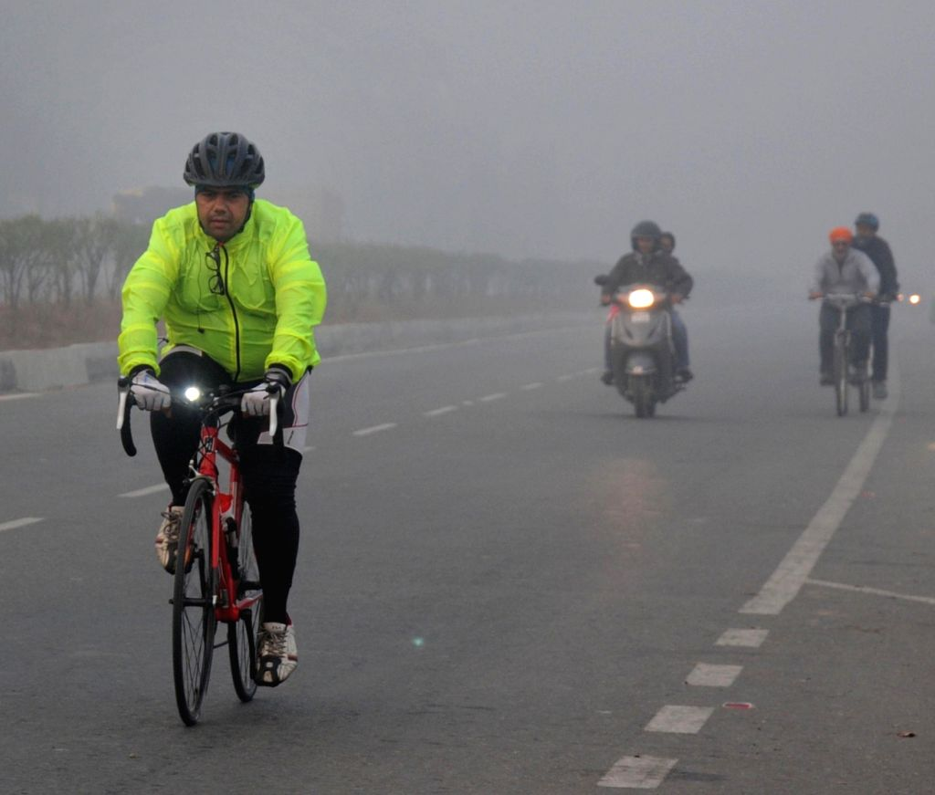 An envelope of heavy fog covers Amritsar, on Jan 19, 2016.