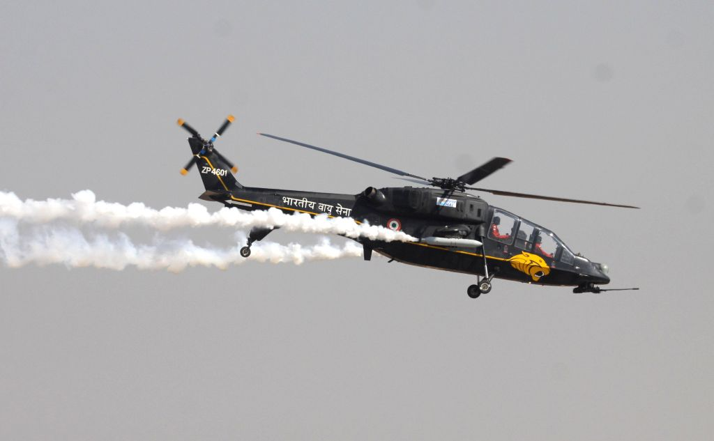 An IAF aircraft performs aerobatics during the Aero India-2015 Air Show, at Yelahanka Air-force Station, in Bengaluru on Feb 18, 2015.