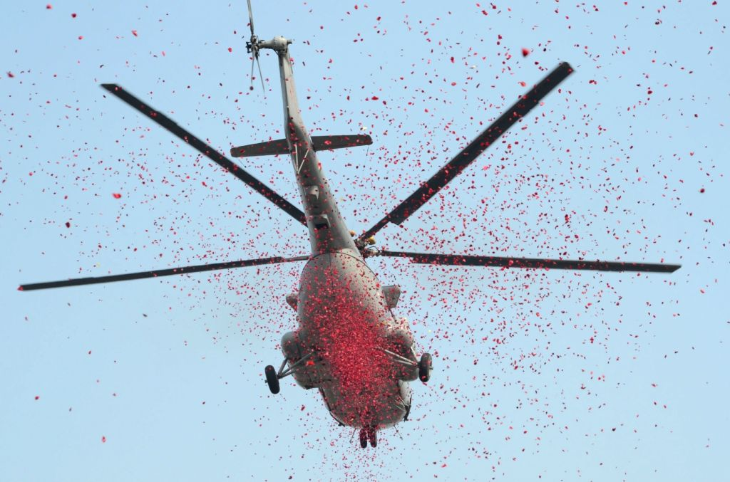 An IAF helicopter sprinkles flower petals during 2019 Republic Day Parade in Kolkata, on Jan 26, 2019.