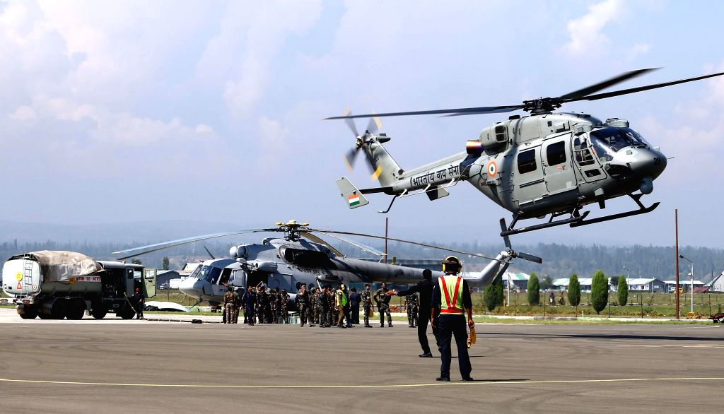 An IAF MI17 V5 Helicopter being refueled during the ongoing relief and rescue operations in flood hit Jammu and Kashmir, in Srinagar.
