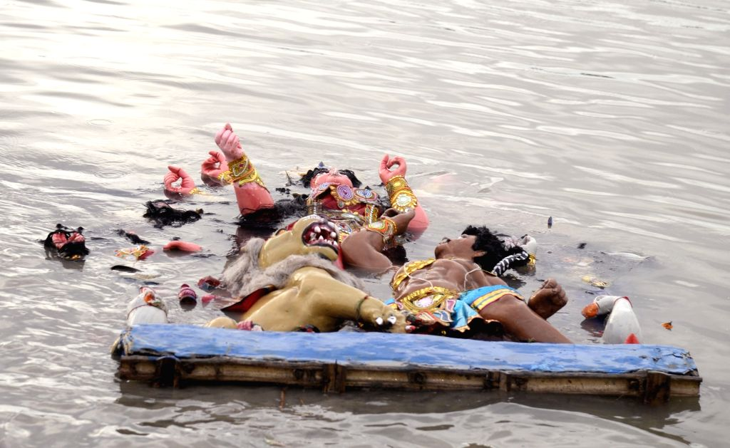 An idol of Goddess Durga after being immersed into the waters of Hooghly River, in Kolkata on Oct 9, 2019.