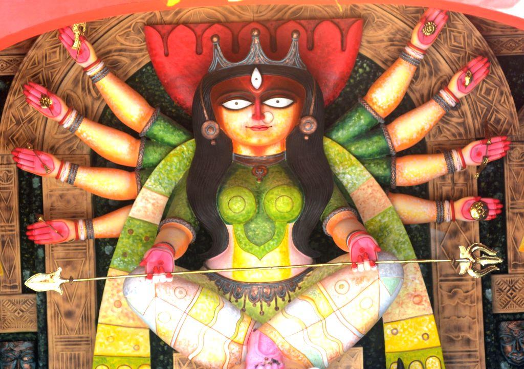 An idol of Goddess Durga at Kumartuli Sarbojanin community puja pandal ahead of Durga Puja celebrations, in Kolkata on Oct 21, 2020.