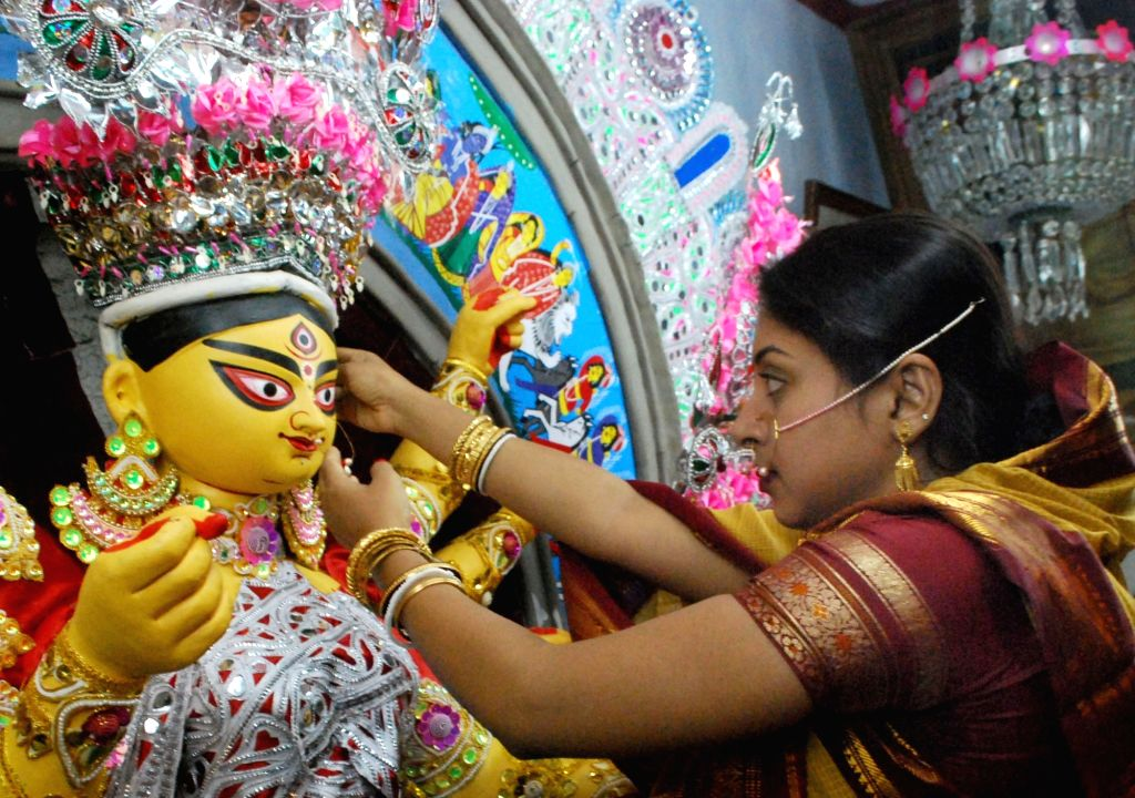 An idol of Goddess Durga being adorned with ornaments for Durga Puja festivities at Kolkata's Dawn Bari. (File Photo: Kuntal Chakrabarty/IANS)