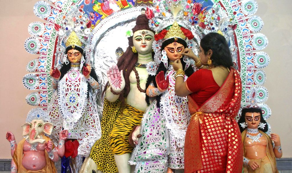 An idol of Goddess Durga being adorned with ornaments for Durga Puja festivities at Kolkata's Dutta Bari. (File Photo: Kuntal Chakrabarty/IANS)