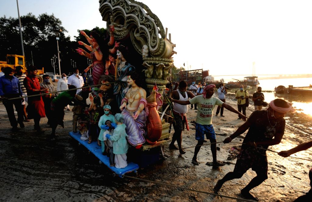 An idol of Goddess Durga being immersed in the Ganga river, in Kolkata on Oct 27, 2020.