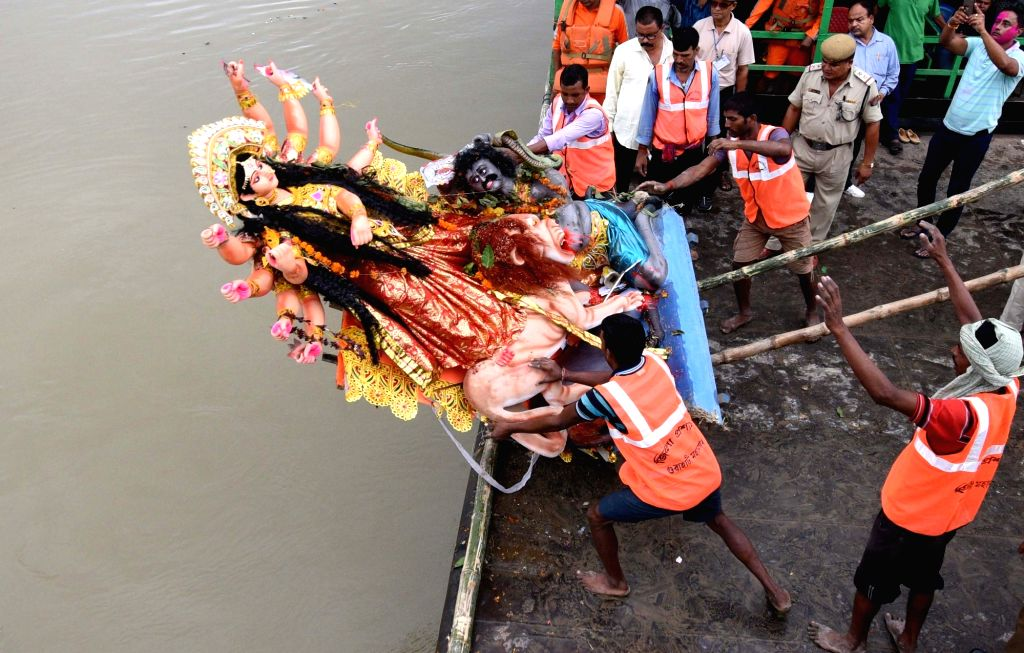 An idol of goddess Durga being immersed in the Brahmaputra river on the last day of Durga Puja in Guwahati on Sept 30, 2017.