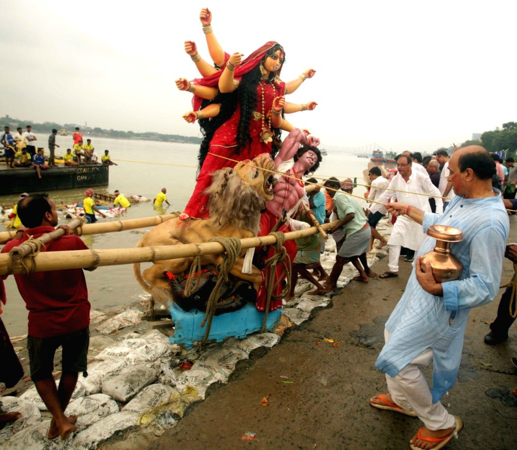 An idol of goddess Durga being immersed in the Hooghly river on the last day of Durga Puja in Kolkata on Sept 30, 2017.