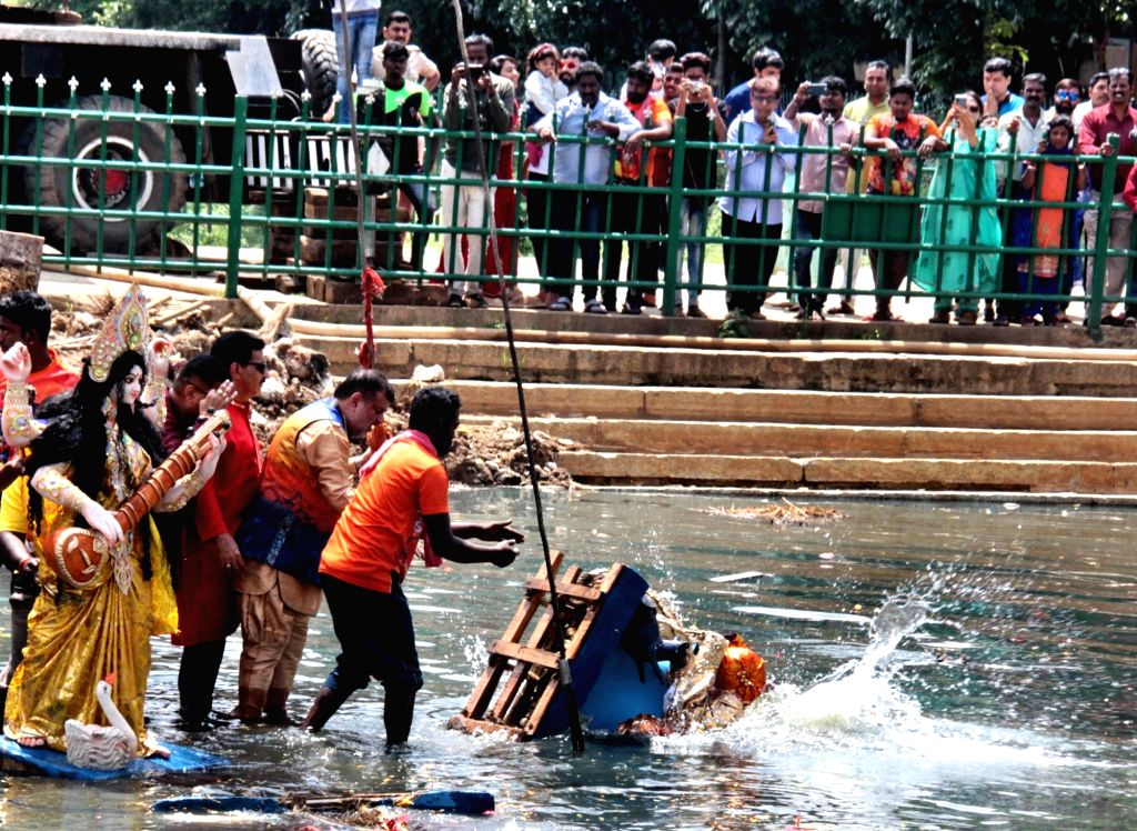 An idol of Goddess Durga being immersed in the waters of Ulsoor Lake on Vijay Dashmi, in Bengaluru on Oct 8, 2019.