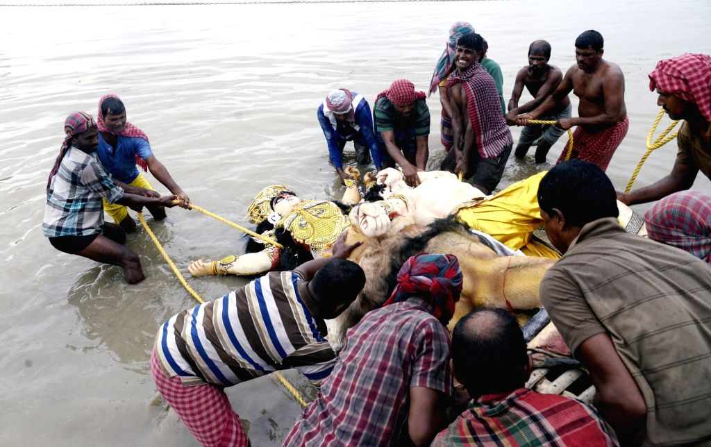 An idol of Goddess Durga being immersed in the waters of Hooghly River, in Kolkata on Oct 9, 2019.