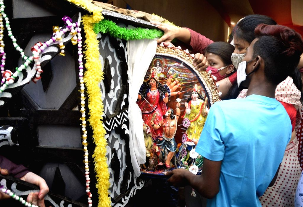 An idol of Goddess Durga being taken in a palanquin for immersion in river Ganga, in Kolkata on Oct 27, 2020.