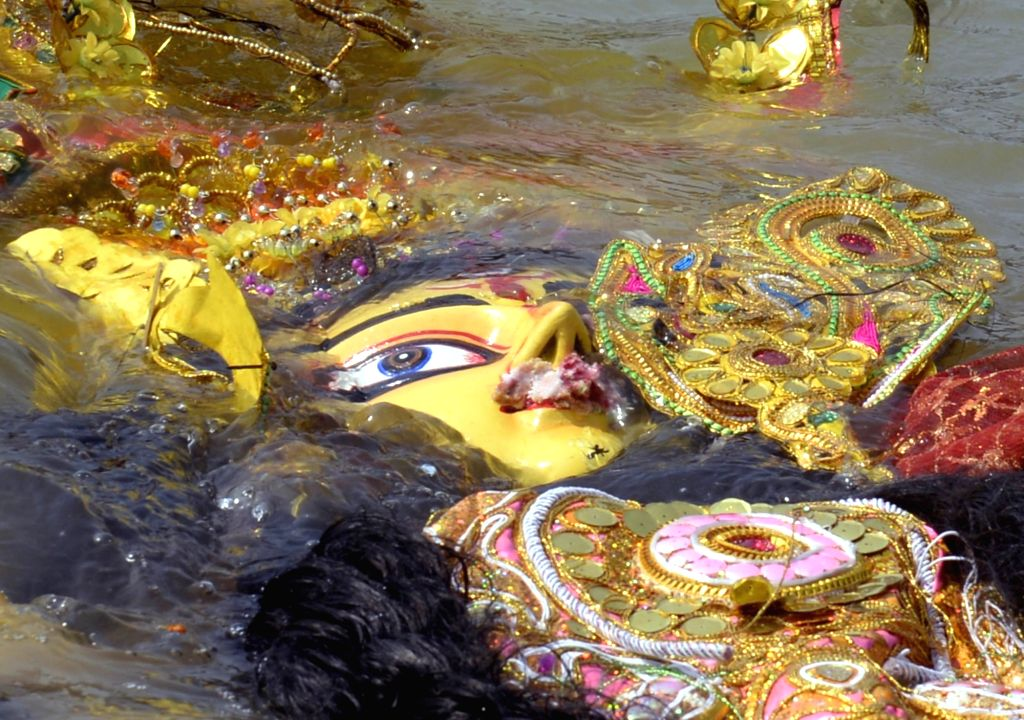 An idol of Goddess Durga immersed in the waters of the Ganga river on Vijayadashami, in Kolkata on Oct 26, 2020.