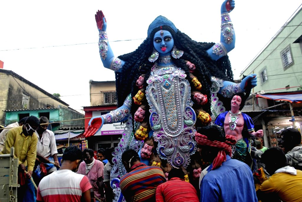 An idol of Goddess Kali being taken to a puja pandal from the Kumartuli workshop on the eve of Kali Puja celebrations, in Kolkata on Nov 13, 2020.