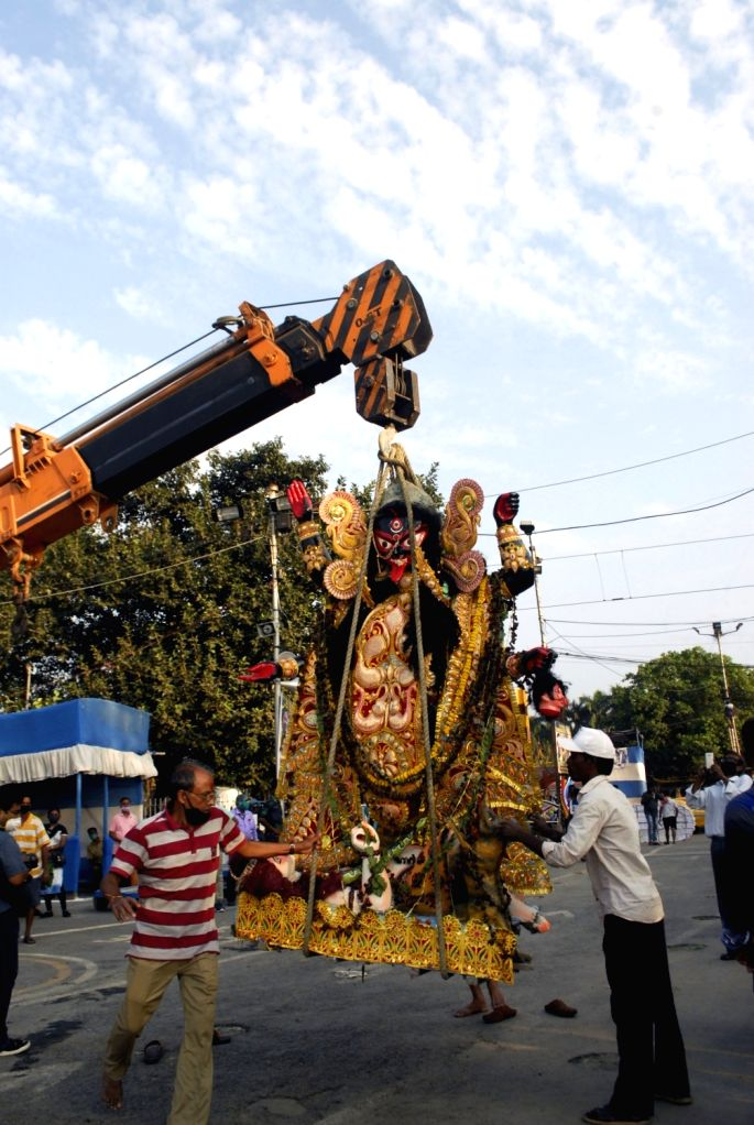 An idol of Goddess Kali being taken to be immersed into the waters of river Ganga in Kolkata, on Nov 16, 2020.