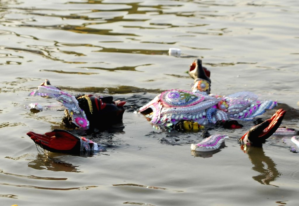 An idol of Goddess Kali immersed into the waters of river Ganga in Kolkata, on Nov 16, 2020.