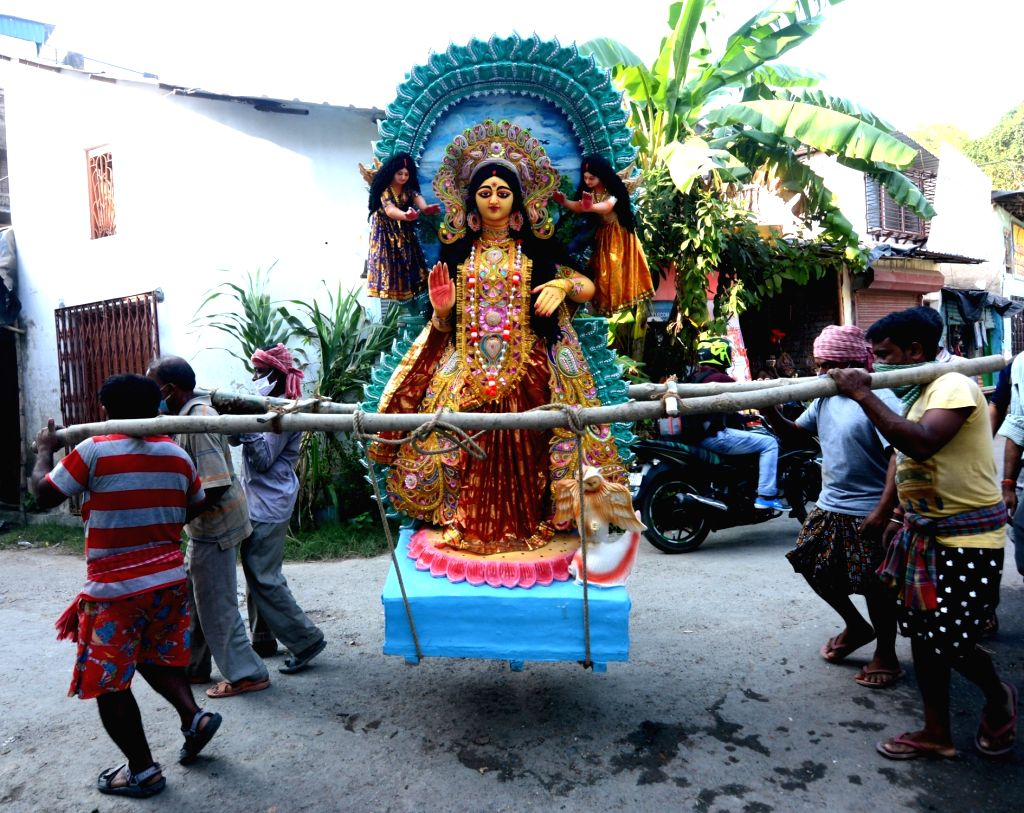 An idol of Goddess Laxmi being carried from the Kumartuli workshop on the eve of Laxmi Puja celebrations in Kolkata on Oct 29, 2020.