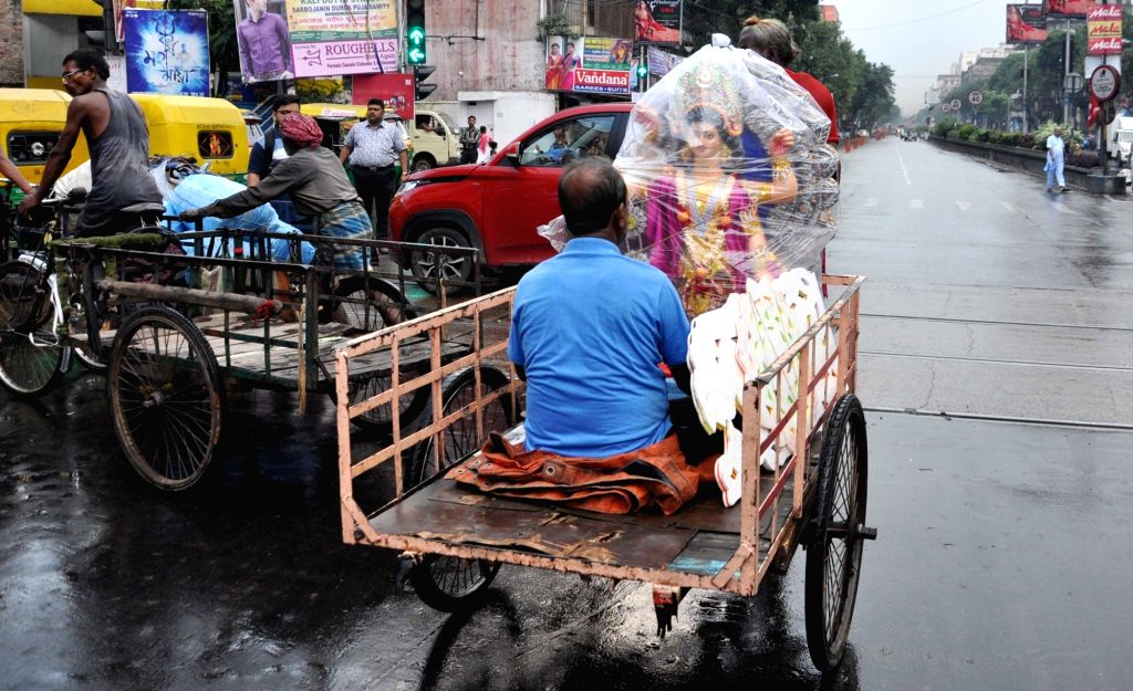 An idol of goddess Vishwakarma being transported from a workshop to its respective pandal ahead of Vishwakarma Puja, in Kolkata on Sept 15, 2018.