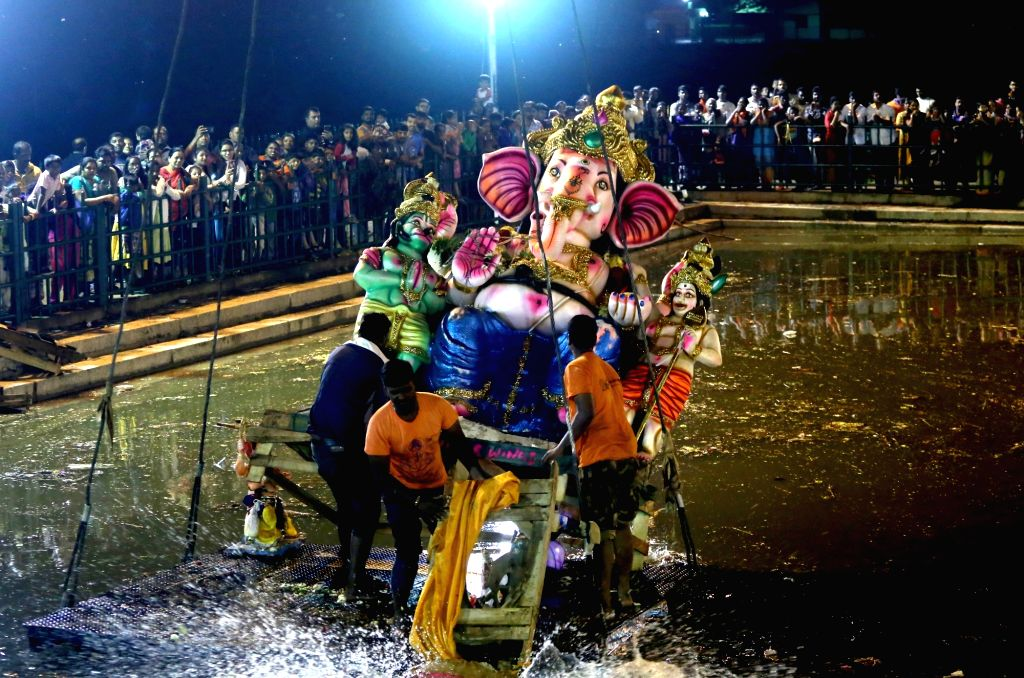 An idol of lord Ganesh being immersed in Bengaluru's Ulsoor Lake on Sept 16, 2018.