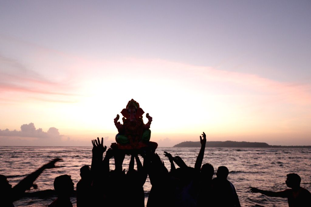 An idol of Lord Ganesha being immersed at Miramar Beach in Goa on Sept 17, 2018.