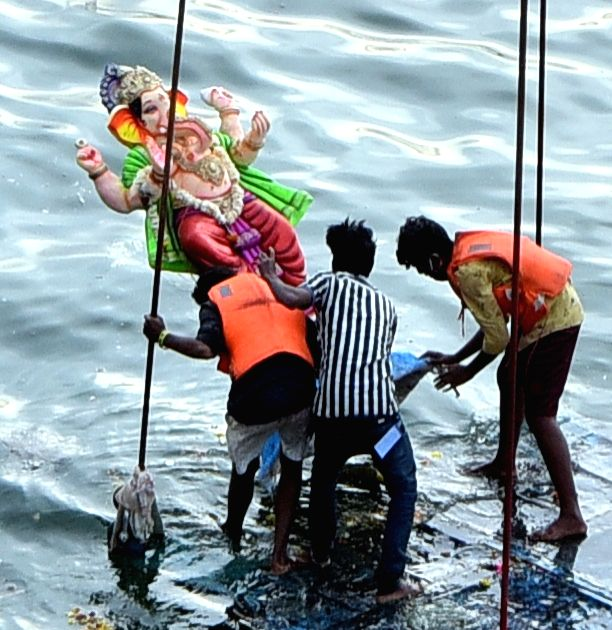 An idol of Lord Ganesha being immersed in the waters of the Hussain Sagar Lake on Anant Chaturdashi or the last day of Ganesh Chaturthi, in Hyderabad on Sep 1, 2020.