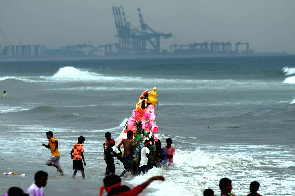 An idol of Lord Ganesha being immersed in the Pattinapakkam beach, in Chennai on Sept 16, 2018.