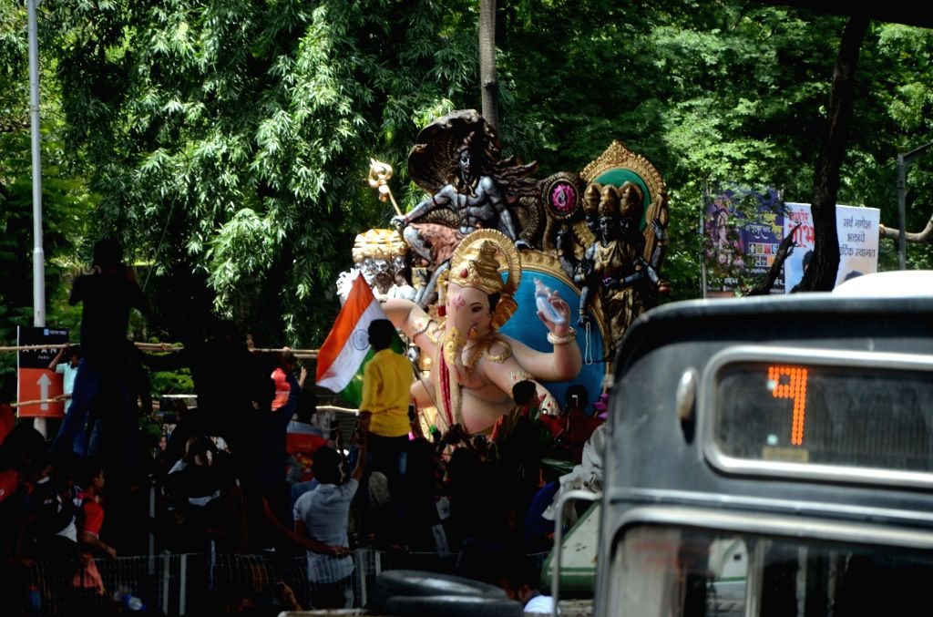 An idol of Lord Ganesha being taken from a Lalbaug workshop to its respective pandal ahead of Ganesh Chaturthi, in Mumbai on Sept 8, 2018.