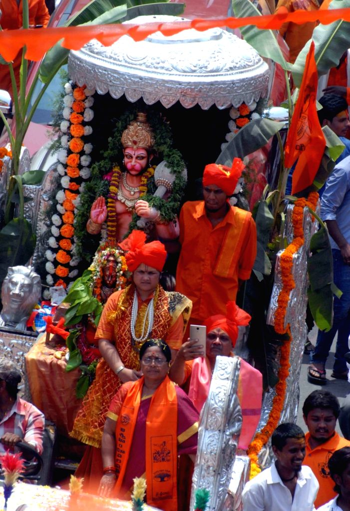 An idol of Lord Hanuman being carried during a religious procession organised on Hanuman Jayanti, in Hyderabad on March 31, 2018.