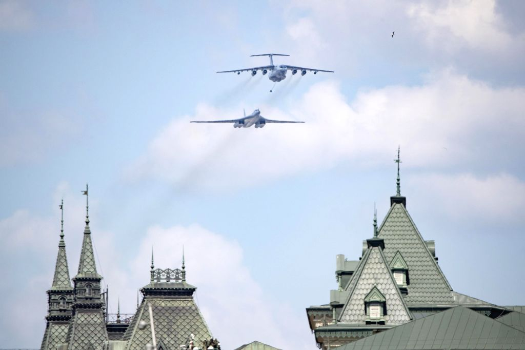 An Il-78 air tanker and a Tu-160 strategic bomber fly over the Red Square during the military parade marking the 75th anniversary of the victory in the Great ...