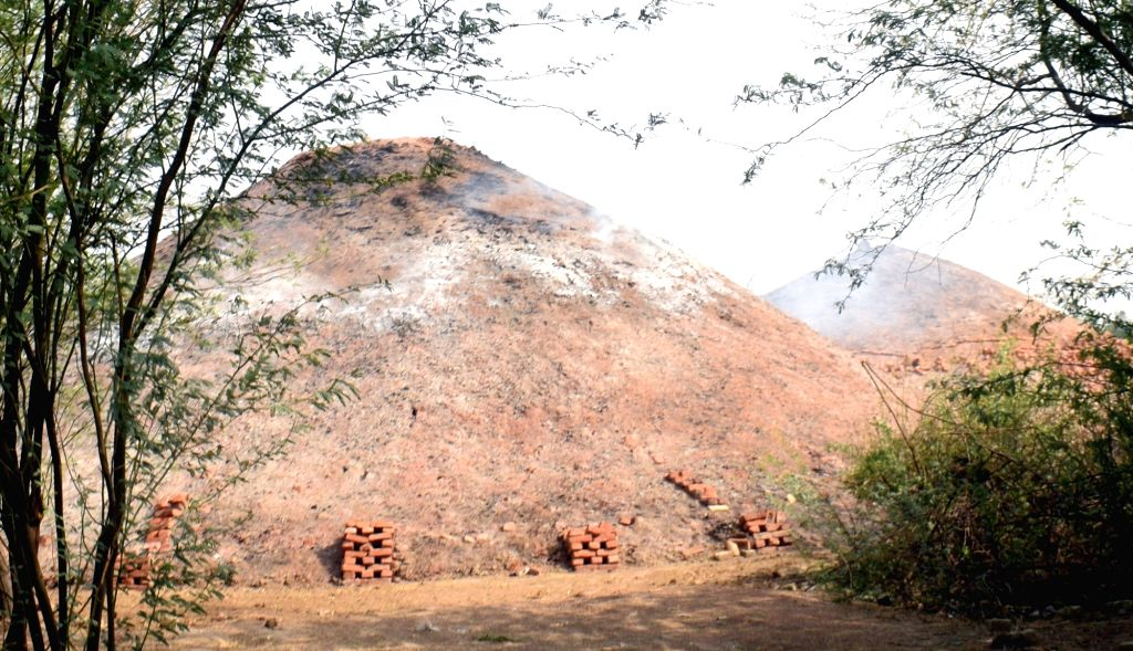 An illegal brick kiln on Jajan Patti-Sonkh road near Agra, on June 7, 2019. Smoke-emitting chimneys of brick kilns, mushrooming in and around Agra, seem to be the cause for discoloration of the ...