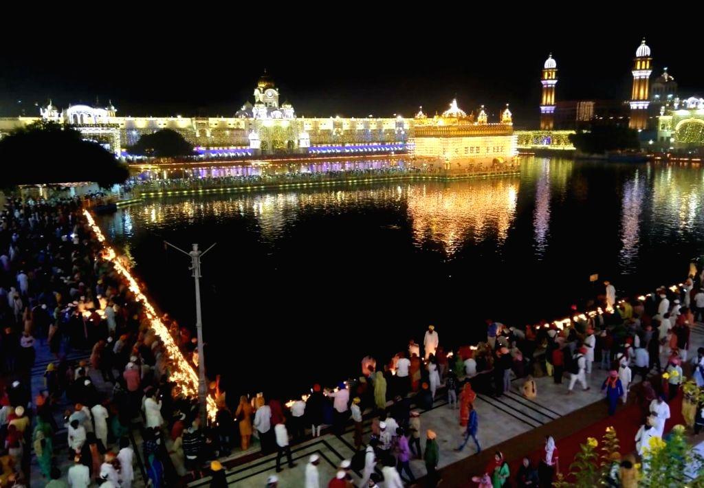 An illuminated Golden Temple on Diwali in Amritsar on Oct 27, 2019.