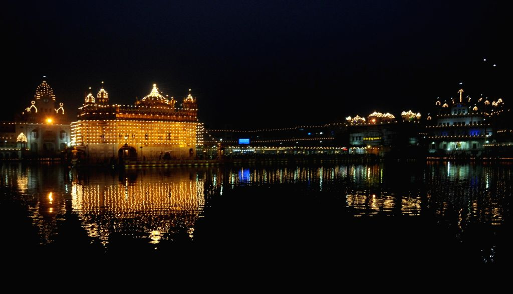An illuminated Golden Temple on the occasion of birth anniversary of 10th Sikh Guru Gobind Singh in Amritsar, on Jan 16, 2016. - Guru Gobind Singh