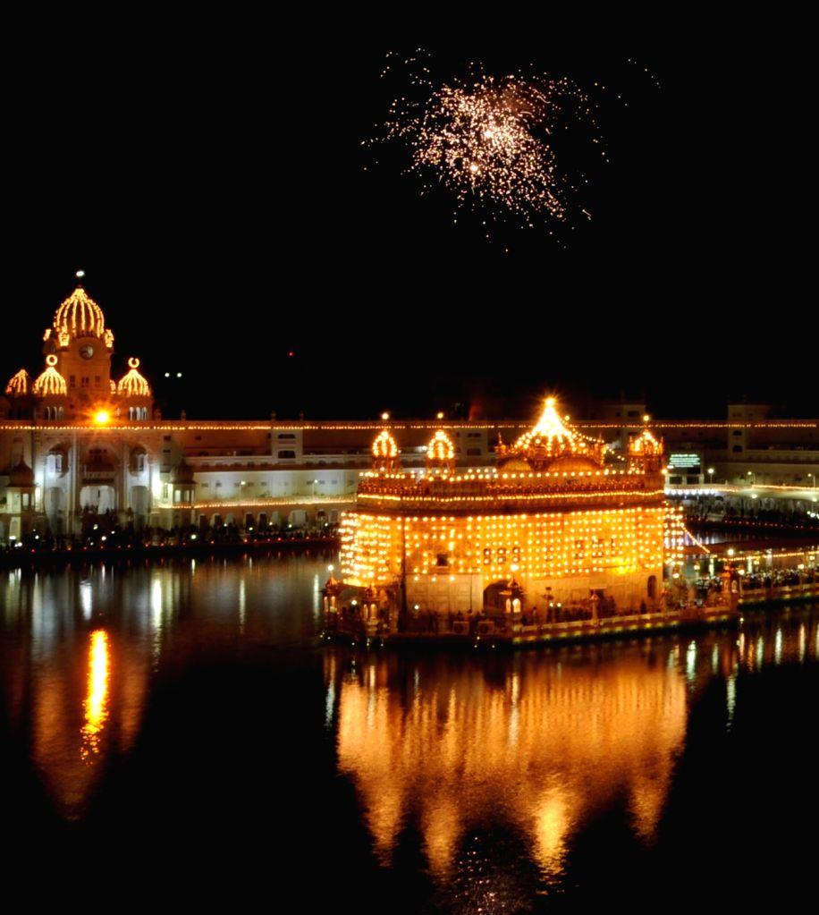 An illuminated Golden Temple on the occasion of birth anniversary of Guru Harkrishan Sahib in Amritsar on July 28, 2016.