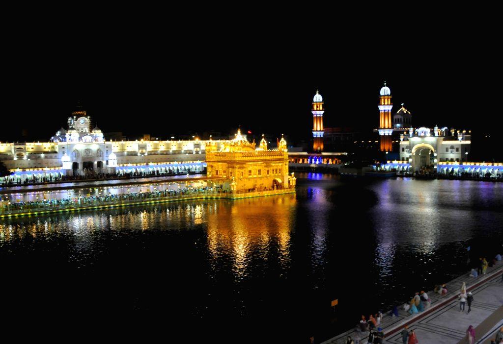 An illuminated Golden Temple on the occasion of birth anniversary celebrations of the ninth Sikh Guru, Guru Tegh Bahadur, in Amritsar on April 24, 2019.
