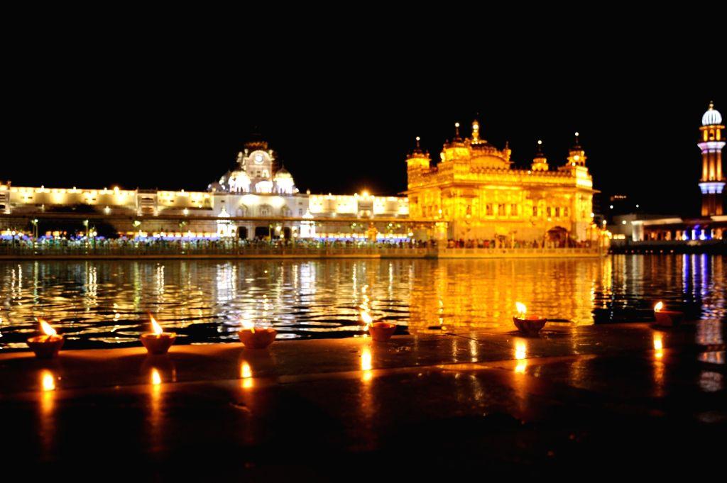 An illuminated Golden Temple on the occasion of 'Gurta Gaddi Diwas' of the sixth Sikh Guru, Guru Hargobind Sahib in Amritsar on May 27, 2019.