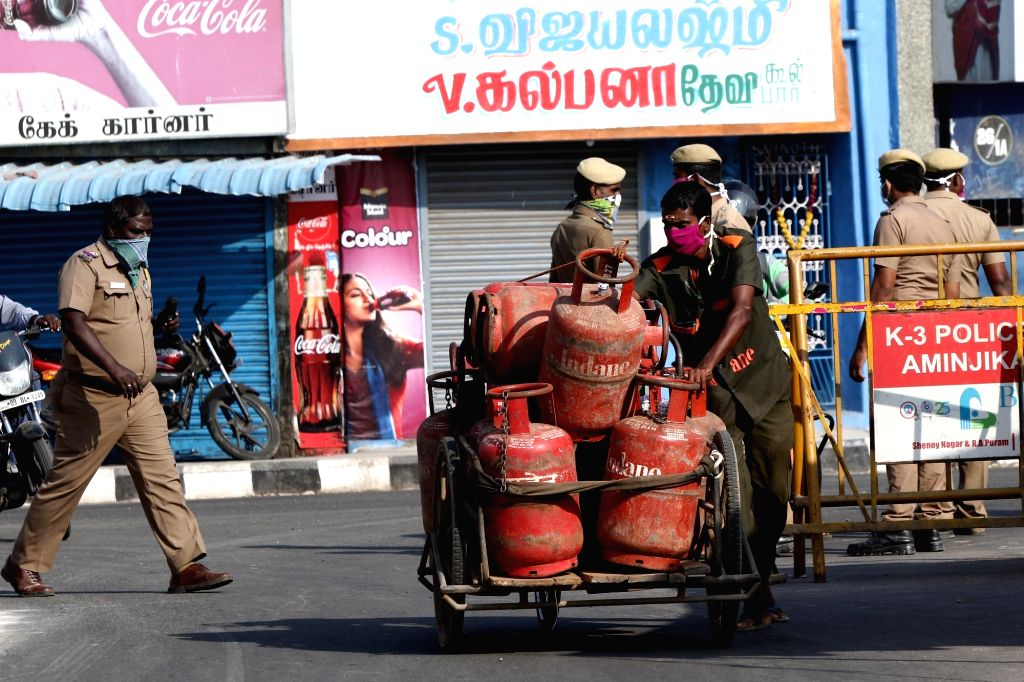 An Indane worker carries LPG Gas cylinders on Day 5 of the 21-day countrywide lockdown imposed to contain the spread of novel coronavirus, in Chennai on March 29, 2020.