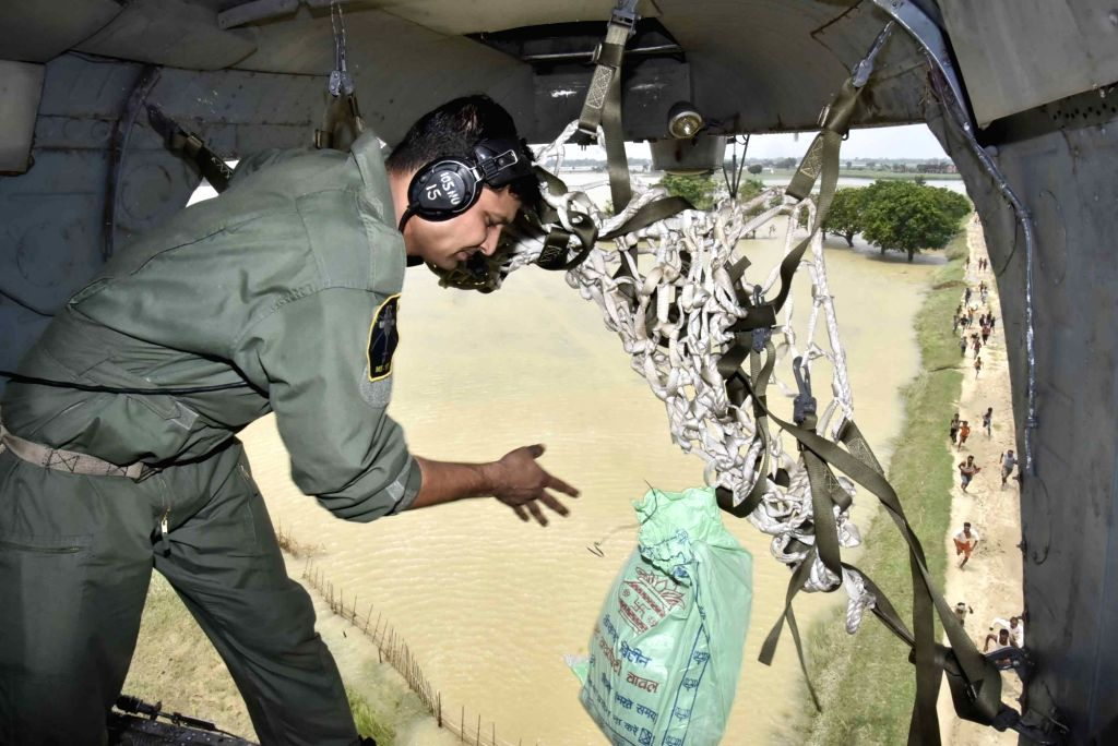 An Indian Air Force (IAF) pilot drops food packages to flood victims in Bettiah, Bihar on Aug 18, 2017.
