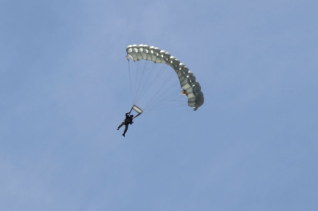 An Indian Air Force personnel displays his skills during an airshow at DefExpo 2018, in Chennai on April 11, 2018.