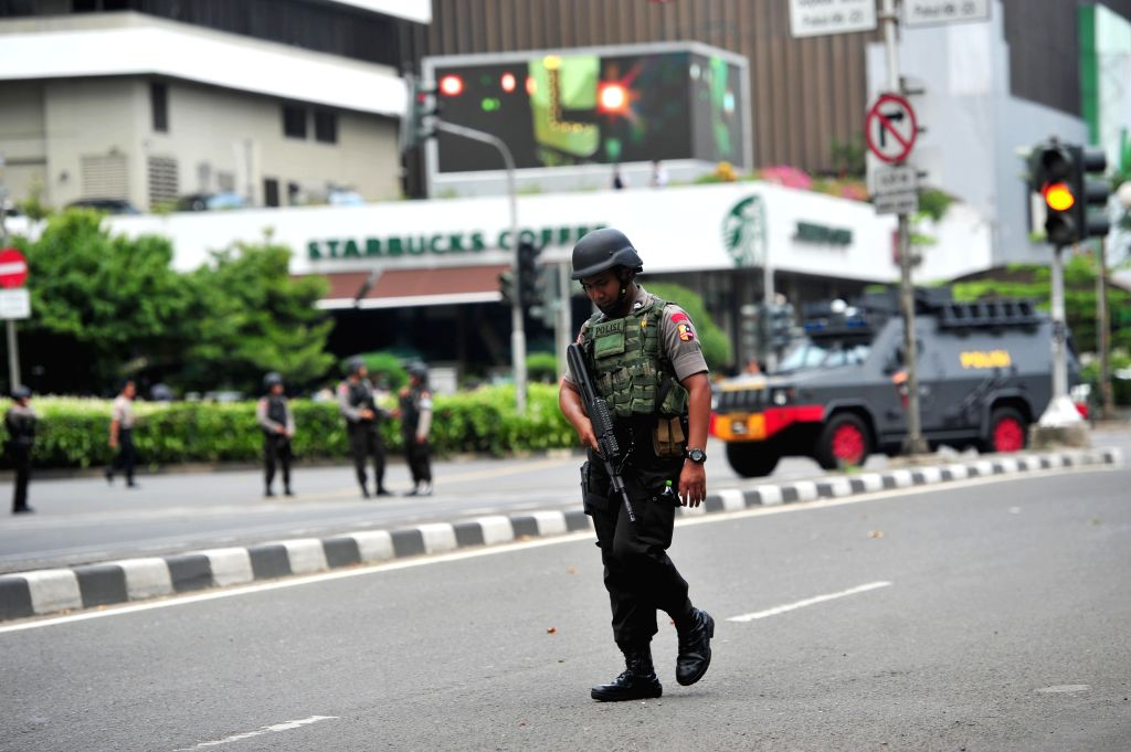 An Indonesian anti-terror policeman guards at the explosion site in Jakarta, Indonesia, Jan. 14, 2016. Indonesian President Joko Widodo on Thursday condemned the ...