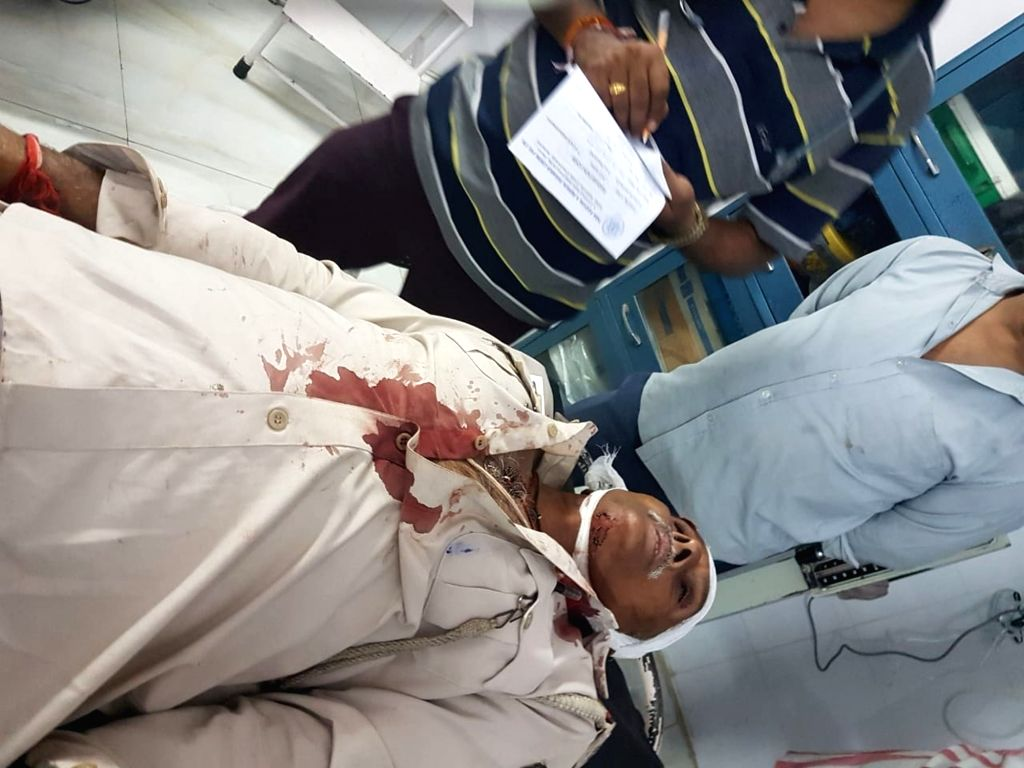 An injured being taken for treatment after police opened fire during a violent clash between with a group of people in a dispute over gambling, in Patna on Nov 5, 2018. Reportedly one person ...