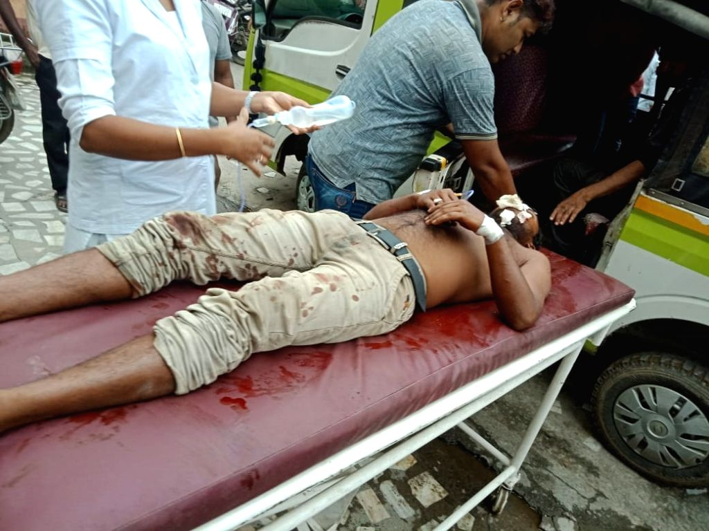 An injured being taken to a hospital after blasts at a scrap dealer's shop at Raja Maidam Road in Jorhat, Assam on July 25, 2019. The blast is suspected to have occurred when the four were ...