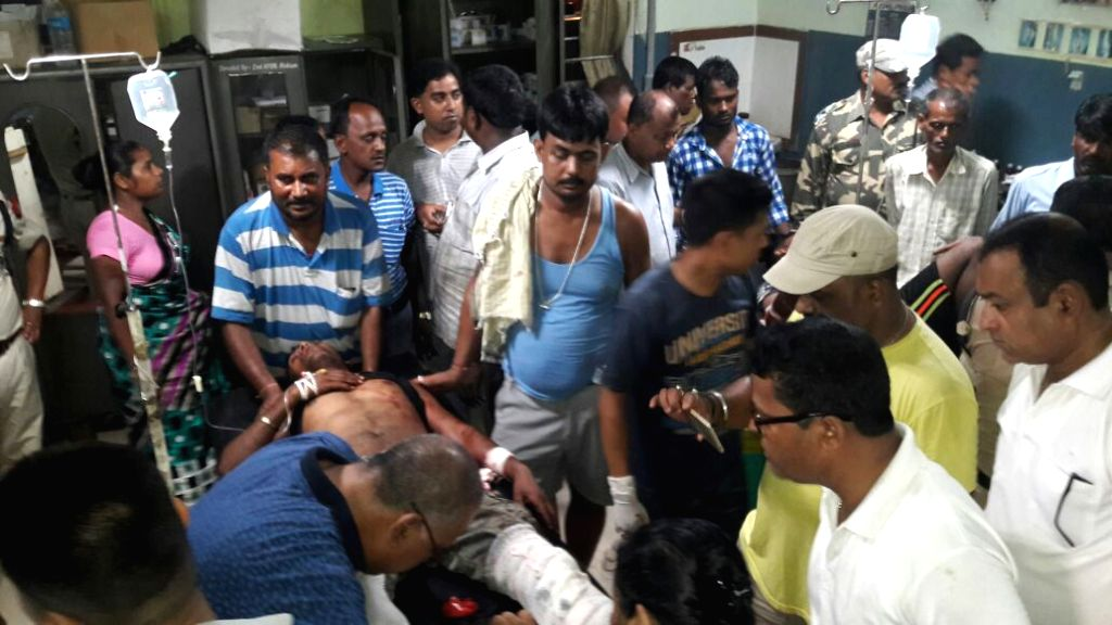 An injured being treated at a hospital after suspected militants opened fired in which two killed and several injured at Bahbon village in Philobari area of Tinsukia district Assam on Aug. ...