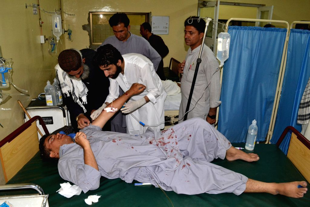 An injured man receives medical treatment at a hospital in southwest Pakistan's Quetta, Aug. 11, 2015. At least two policemen were killed and six other people were ...