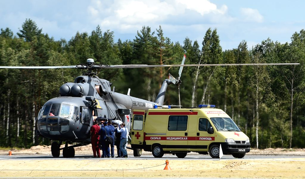 An injured pilot is transferred from the scene of the helicopter crash in Ryazan, Russia, Aug. 2, 2015. A Mi-28N helicopter crashed while preforming a demonstration ...