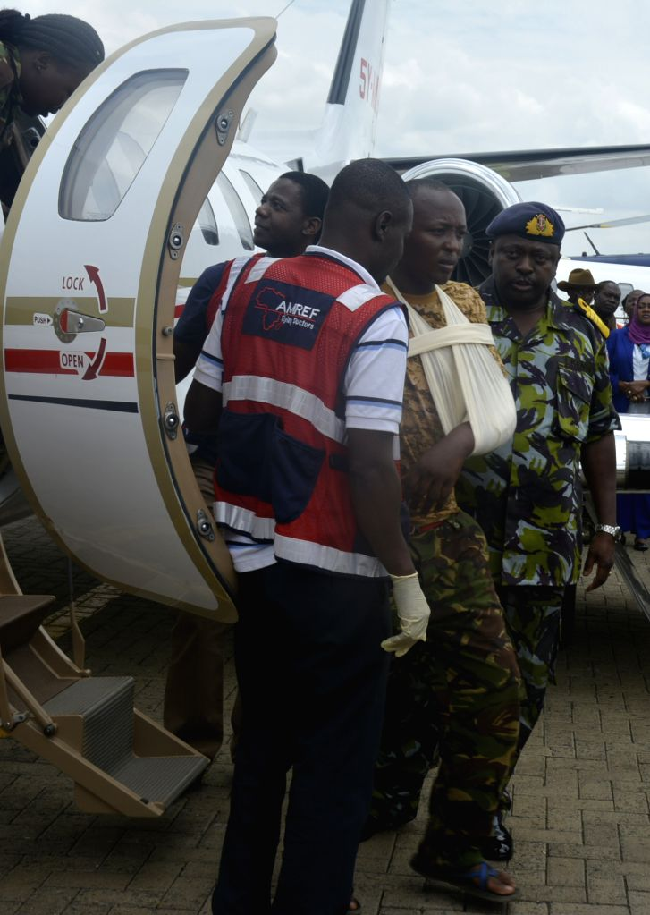 An injured soldier disembarks from an aircraft at Wilson Airport in Nairobi, Kenya, on Jan. 17, 2015. The Kenyan government has started evacuating its soldiers ...