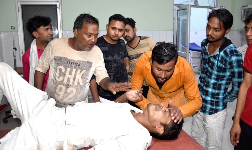 An injured undergoing treatment at a hospital after lightening killed one in Mathura last night, on June 13, 2019.