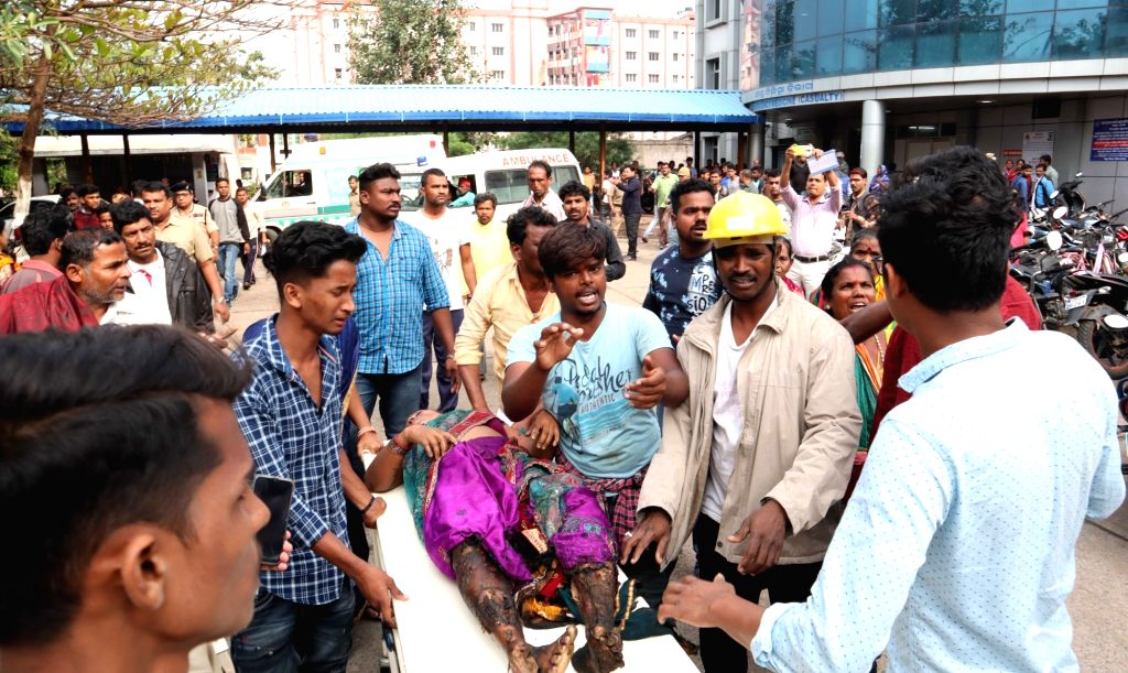 An injured woman being taken to a hospital after a bus came in contact with an 11 KV power transmission line, electrocuting five passengers to death and injuring over 30, in Odisha's Ganjam ...