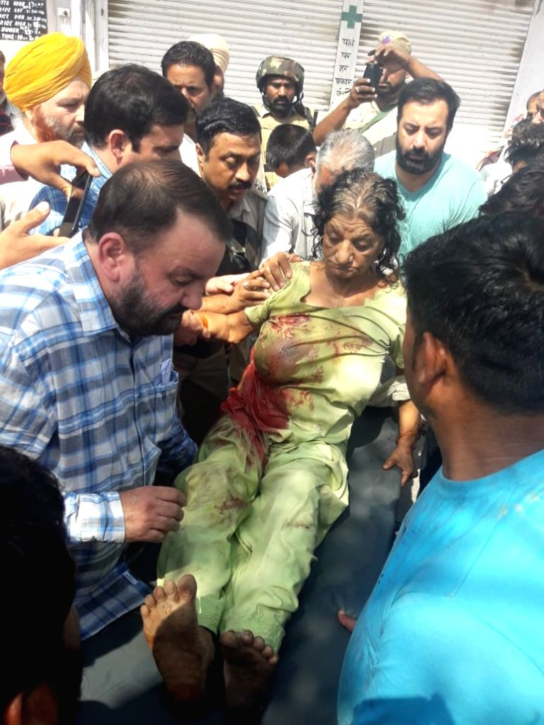 An injured woman being taken to the hospital for treatment, in Jammu on May 21, 2018. Pakistani rangers had violated ceasefire on the international border (IB) in Jammu and Samba districts. ...