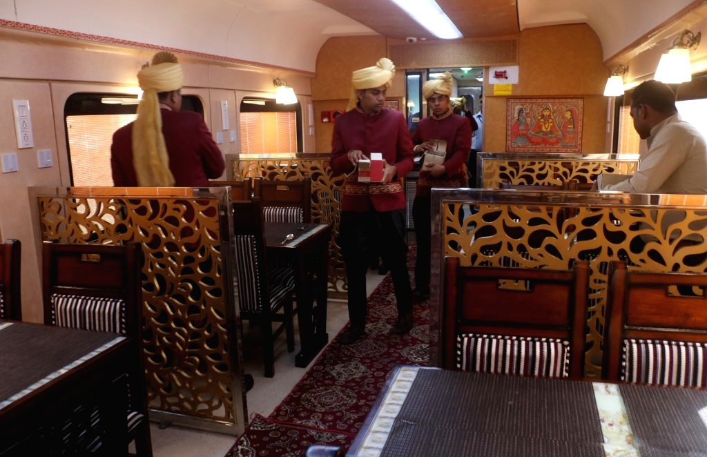An inside view of the fine dining restaurant car of the Buddhist Circuit special train reintroduced by the Indian Railways, during media preview at Safdarjung railway station in New Delhi ...