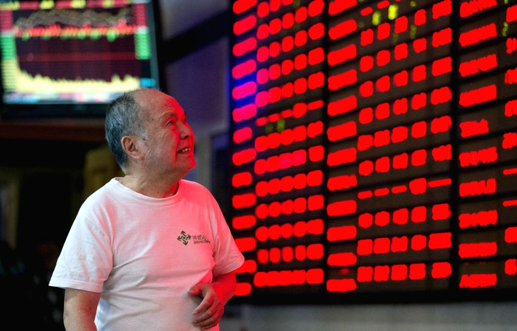An investor in the trading hall of a Chinese securities firm in Nanjing, China. (File Photo: Xinhua/Su Yang/IANS)