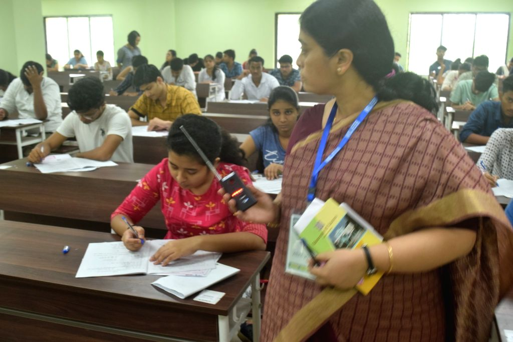 An invigilator on duty during the Joint Entrance Examination (JEE) 2019 in Kolkata, on May 26, 2019.