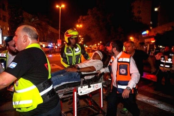 An Israeli man injured after a rocket from the Gaza strip landed is evacuated in central Israeli city of Holon, on May 11, 2021.